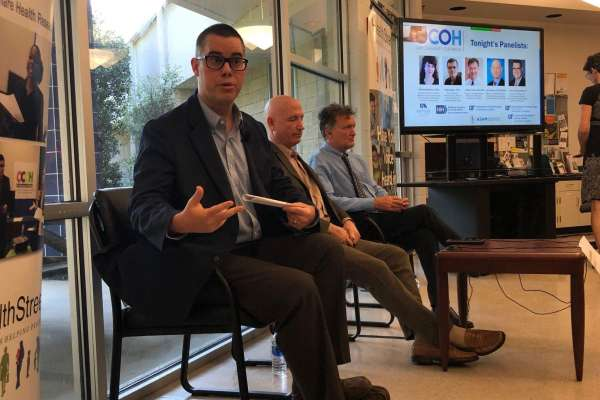 Patrick Tighe (left), a UF associate professor of anesthesiology starts off the Town Hall Medical Marijuana at UF HealthStreet. He sits alongside two other panelist, Jay Kuchera (middle), a board-certified anesthesiologist and Robert Cook (right), UF Epidemiology Professor.